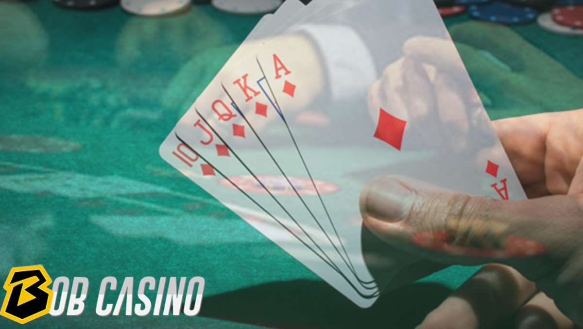 Player Holding Cards While Playing Poker