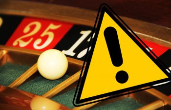 Online Roulette myths and misconceptions hovering above a Roulette wheel.