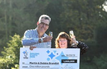 The Brandist couple with their £1 million lottery win after 25 years of using the same numbers.