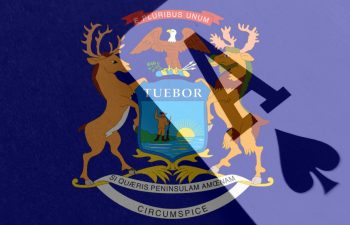 Michigan state flag signaling the legalization of online gambling, poker and betting in the state.