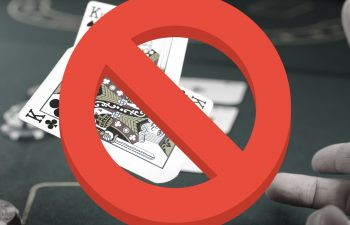 A person playing poker crossed out, as VIP gambling in UK might be banned
