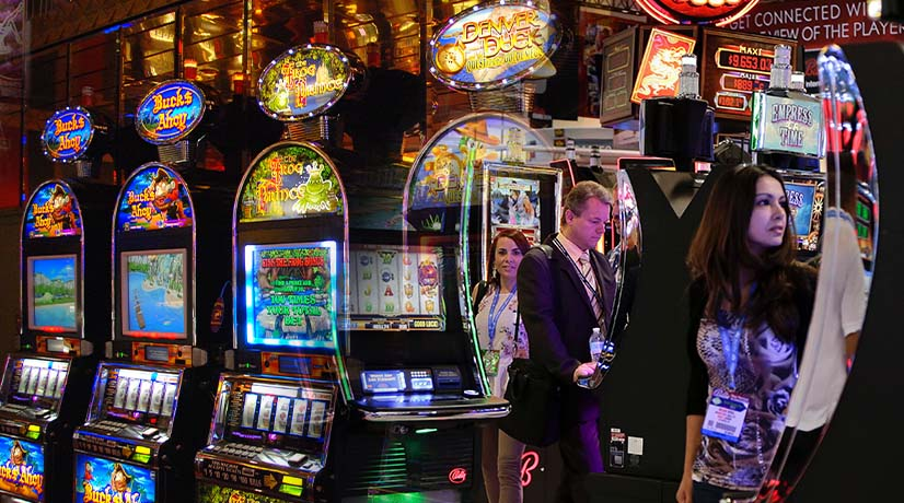 People playing video slot machines in a casino