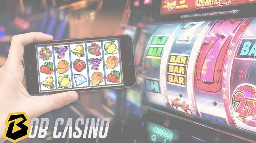Online slots on mobile near the mechanical slot reels.